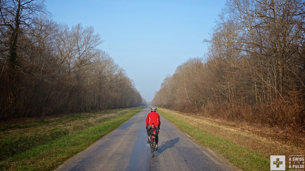 Chris riding on the quiet roads of French Jura