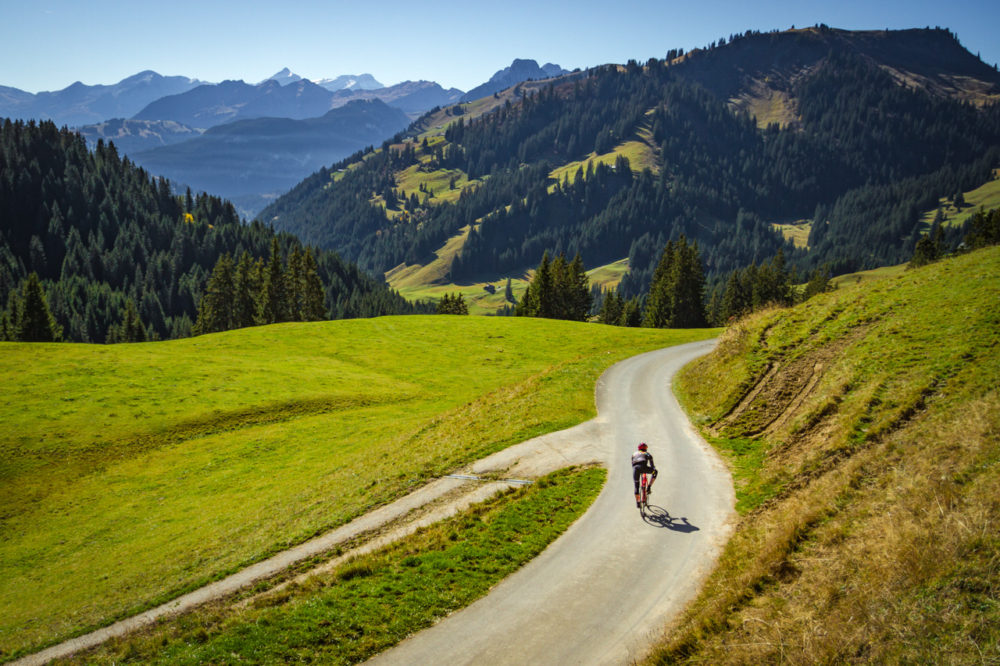 Lone cyclist descending Mittelbergpass in Switzterland